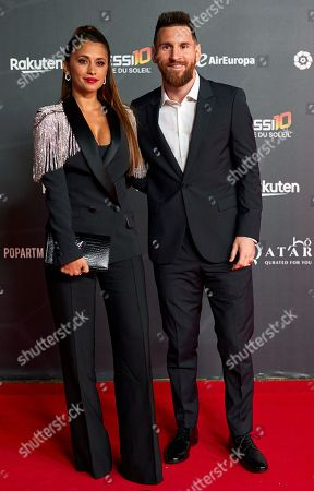 FC Barcelona's forward Lionel Messi (R) from Argentina and his wife Antonela Rocuzzo (L) pose for the media upon arrival to the premiere of the Cirque du Soleil 'Messi 10' spectacle in Barcelona, Catalonia, Spain, 10 October 2019.