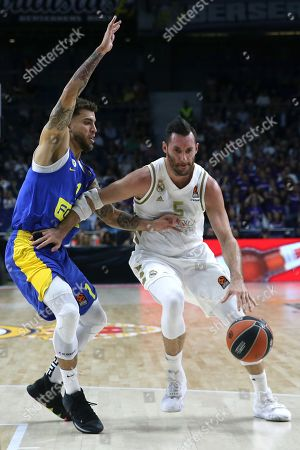 Stock Photo of Real Madrid's forward Rudy Fernandez (R) in action against Maccabi's guard Scottie Wilbekin (L) during the Euroleague basketball match between Real Madrid and Maccabi Fox Tel-Aviv at Wizink Center, in Madrid, Spain, 10 October 2019.