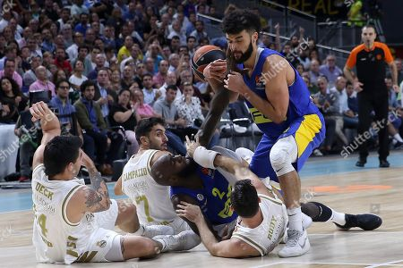 Real Madrid's forwards Gabriel Deck (L) and Rudy Fernandez (2-R), guard Facundo Campazzo (2-L) in action against Maccabi's forward Quincy Acy (3-R) and guard Elijah Bryant (R) during the Euroleague basketball match between Real Madrid and Maccabi Fox Tel-Aviv at Wizink Center, in Madrid, Spain, 10 October 2019.