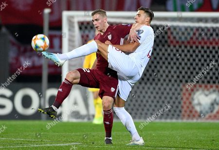 Latvia Israel Euro 2020 Soccer Jan Bednarek Valdislavs Gutkovskis. Latvia's Vladislavs Gutkovskis, left, is challenged by Poland's Jan Bednarek, right, during their Euro 2020 group G qualifying soccer match between Latvia and Poland in Riga, Latvia