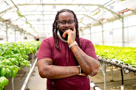 """This photo shows rapper T-Pain, host of """"T-Pain's School of Business,"""" posing for a portrait at Gotham Greens in the Brooklyn borough of New York. The program explores niche, innovative businesses founded by millennials. Many are centered on new technology and forward-thinking concepts"""