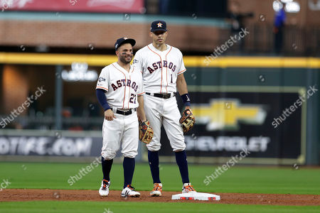 Jose Altuve, Carlos Correa. Houston Astros second baseman Jose Altuve (27) and Houston Astros shortstop Carlos Correa (1) during the third inning of Game 5 of a baseball American League Division Series against the Tampa Bay Raysin Houston