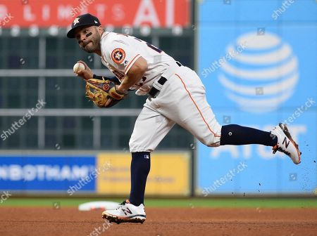 Houston Astros second baseman Jose Altuve (27) fields a ground ball by Tampa Bay Rays center fielder Kevin Kiermaier during the fifth inning of Game 5 of a baseball American League Division Series in Houston, . Kiermaier was out a first base
