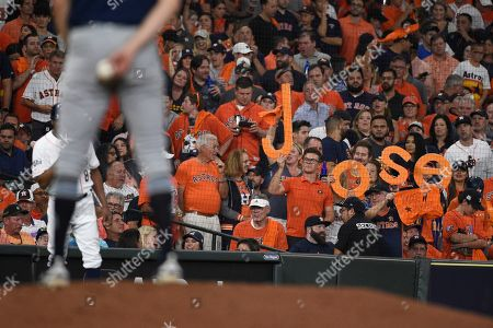 Houston Astros fans cheer for Houston Astros second baseman Jose Altuve during the fifth inning of Game 5 of a baseball American League Division Series against the Tampa Bay Rays in Houston
