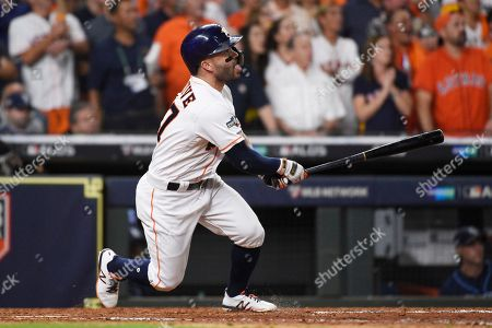 Houston Astros second baseman Jose Altuve (27) watches his solo homer against the Tampa Bay Rays during the eighth inning of Game 5 of a baseball American League Division Series in Houston