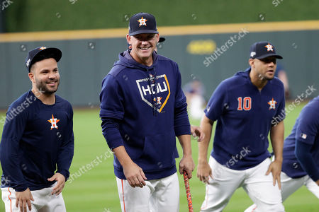 Jose Altuve, AJ Hinch. Houston Astros second baseman Jose Altuve, talks with Houston Astros manager AJ Hinch, center, before Game 5 of a baseball American League Division Series against the Tampa Bay Rays in Houston
