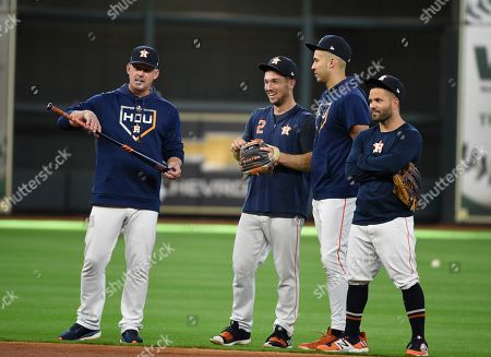 AJ Hinch, Alex Bregman, Carlos Correa, Jose Altuve. Houston Astros manager AJ Hinch, left, with third baseman Alex Bregman (2), shortstop Carlos Correa (1) and second baseman Jose Altuve, right, before Game 5 of a baseball American League Division Series in Houston