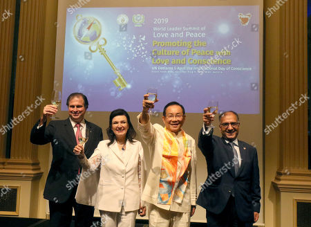 From left, Sandor and Herta Habsburg-Lothringen, leaders of the Flame of Peace; Dr. Hong, Tao-Tze, president of the Federation of World Peace and Love; Dr. Yusuf Abdulkarim Bucheeri, Permanent Representative of Bahrain to the UN (Vienna), give a toast to their guests during a gala dinner in Vienna, Autria on . The event was to celebrate the United Nations' designation of April 5 as the International Day of Conscience
