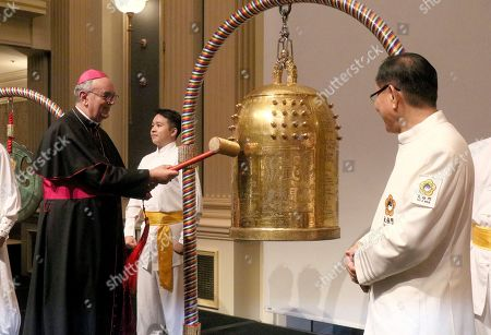 Stock Picture of Dr. Camillo Ballin, Apostolic Vicar of Northern Arabia, left, rings the Bell of World Peace and Love during a gala dinner in Vienna, Austria on . The event was co-organized by the Federation of World Peace and Love, the Permanent Mission of Bahrain to the UN (Vienna), and the Flame of Peace to celebrate the United Nations' designation of April 5 as the International Day of Conscience
