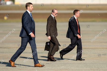 Eric Trump, left, adviser Stephen Miller and acting White House chief of staff Mick Mulvaney, right, walk towards Air Force One for a trip to Minneapolis for a campaign rally, at Andrews Air Force Base, Md
