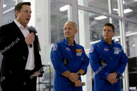 SpaceX chief engineer Elon Musk, left, talks with and NASA astronauts crew Doug Hurley and Bob Behnken, right, about the progress to fly astronauts to and from the International Space Station, from American soil, as part of the agency's commercial crew program at SpaceX headquarters, in Hawthorne, Calif