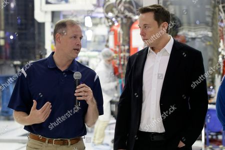 NASA Administrator Jim Bridenstine, left, talks with SpaceX chief engineer Elon Musk about the progress to fly astronauts to and from the International Space Station, from American soil, as part of the agency's commercial crew program at SpaceX headquarters, in Hawthorne, Calif