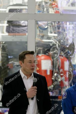 SpaceX chief engineer Elon Musk speaks in front of the Crew Dragon spacecraft about the progress to fly astronauts to and from the International Space Station, from American soil, as part of the agency's commercial crew program at SpaceX headquarters, in Hawthorne, Calif
