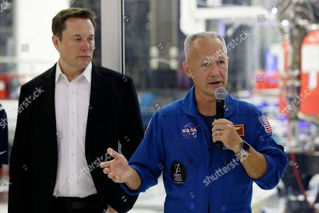 NASA astronauts crew Doug Hurley, right, answers a question from the media, with SpaceX founder Elon Musk, left, about the progress to fly astronauts to and from the International Space Station, from American soil, as part of the agency's commercial crew program at SpaceX headquarters, in Hawthorne, Calif