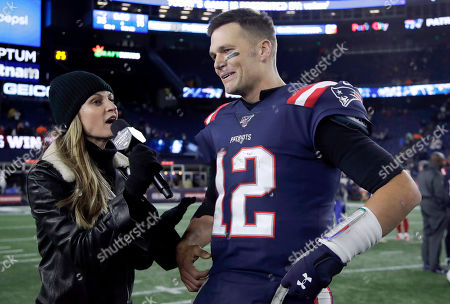 Stock Picture of Fox Sports television sideline broadcast reporter Erin Andrews, left, interviews New England Patriots quarterback Tom Brady at midfield after an NFL football game between the Patriots and the New York Giants, in Foxborough, Mass