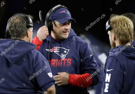 New England Patriots special teams coach Joe Judge, center, speaks to head coach Bill Belichick, left, and safeties coach Steve Belichick, right, in the second half of an NFL football game, in Foxborough, Mass
