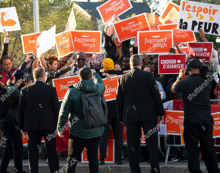 New Democrat Party (NDP) leader Jagmeet Singh (C-rear) embraces a supporter as he arrives for a political leaders debate in Gatineau, Quebec, Canada, 10 October 2019. Canadians will vote in the country's 43rd general election on 21 October 2019.