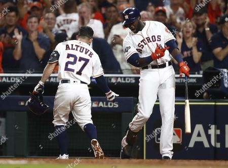 Houston Astros batter Jose Altuve (L) celebrates with teammate Yordan Alvarez (R) after hitting a solo home run against Tampa Bay Rays pitcher Emilio Pagan in the bottom of the eighth inning of their MLB American League Divsion Series playoff baseball game five at Minute Maid Park in Houston, Texas, USA, 10 October 2019. The best-of-five series is tied 2-2 so the game five winner will go on to face the New York Yankees in the American League Championship Series.