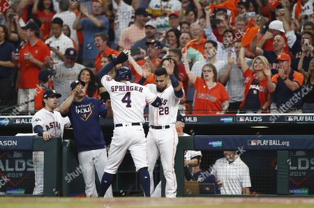 Houston Astros baserunner George Springer (C) celebrates with teammates after scoring on Jose Altuve's RBI single against the Tampa Bay Rays in the bottom of the first inning of their MLB American League Divsion Series playoff baseball game five at Minute Maid Park in Houston, Texas, USA, 10 October 2019. The best-of-five series is tied 2-2 so the game five winner will go on to face the New York Yankees in the American League Championship Series.