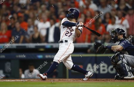 Houston Astros batter Jose Altuve hits an RBI single against the Tampa Bay Rays in the bottom of the first inning of their MLB American League Divsion Series playoff baseball game five at Minute Maid Park in Houston, Texas, USA, 10 October 2019. The best-of-five series is tied 2-2 so the game five winner will go on to face the New York Yankees in the American League Championship Series.