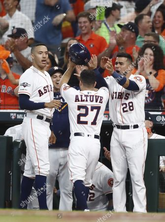 Houston Astros baserunner Jose Altuve (C) celebrates with teammates after scoring on batter Alex Bregman's two-run double against the Tampa Bay Rays in the bottom of the first inning of their MLB American League Divsion Series playoff baseball game five at Minute Maid Park in Houston, Texas, USA, 10 October 2019. The best-of-five series is tied 2-2 so the game five winner will go on to face the New York Yankees in the American League Championship Series.