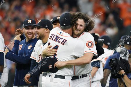 Houston Astros starting pitcher Gerrit Cole, right, and Houston Astros manager AJ Hinch (14) celebrate after the team's 6-1 win over the Tampa Bay Rays in Game 5 of a baseball American League Division Series in Houston