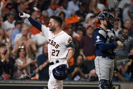 Houston Astros' Jose Altuve (27) celebrates his solo home run against the Tampa Bay Rays during the eighth inning of Game 5 of a baseball American League Division Series in Houston