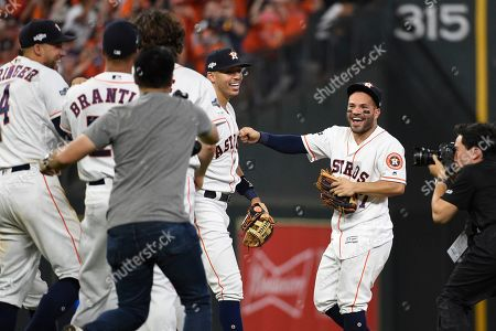 Houston Astros' Jose Altuve, right, celebrates with teammates after their 6-1 win in Game 5 of a baseball American League Division Series in Houston, . Houston won 6-1