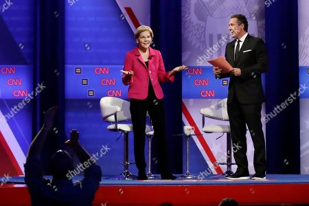 Stock Photo of Elizabeth Warren, Chris Cuomo. Democratic presidential candidate Sen. Elizabeth Warren, center, D-Mass., speaks as CNN moderator Chris Cuomo listens during the Power of our Pride Town Hall, in Los Angeles. The LGBTQ-focused town hall featured nine 2020 Democratic presidential candidates