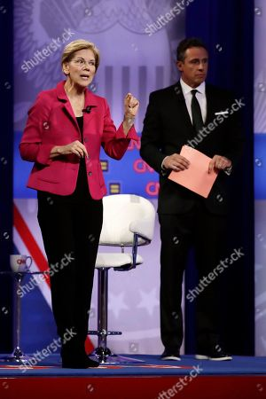 Stock Picture of Elizabeth Warren, Chris Cuomo. Democratic presidential candidate Sen. Elizabeth Warren, center, D-Mass., speaks as CNN moderator Chris Cuomo listens during the Power of our Pride Town Hall, in Los Angeles. The LGBTQ-focused town hall featured nine 2020 Democratic presidential candidates