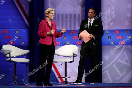 Elizabeth Warren, Chris Cuomo. Democratic presidential candidate Sen. Elizabeth Warren, center, D-Mass., speaks as CNN moderator Chris Cuomo listens during the Power of our Pride Town Hall, in Los Angeles. The LGBTQ-focused town hall featured nine 2020 Democratic presidential candidates