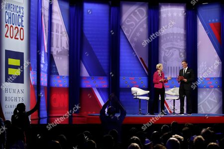 Elizabeth Warren, Chris Cuomo. Democratic presidential candidate Sen. Elizabeth Warren, D-Mass., speaks as CNN moderator Chris Cuomo, right, listens during the Power of our Pride Town Hall, in Los Angeles. The LGBTQ-focused town hall featured nine 2020 Democratic presidential candidates