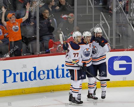 Oscar Klefbom, Connor McDavid, James Neal. Edmonton Oilers defenseman Oscar Klefbom (77), center Connor McDavid (97) and left wing James Neal (18) learn that there will be a video replay of McDavid's third-period, game-tying goal against the New Jersey Devils in an NHL hockey game, in Newark, N.J. The call on the ice was upheld after the replay. The Oilers won 4-3 in a shootout