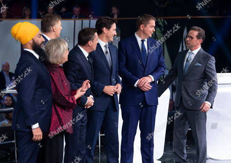 Debate host Patrice Roy from Radio-Canada (3-L) introduces Canadian federal party leaders NDP leader Jagmeet Singh (L), Green Party leader Elizabeth May (2-L), People's Party of Canada leader Maxime Bernier (2-L, rear), Liberal leader Justin Trudeau (3-R), Conservative leader Andrew Scheer (2-R), and Bloc Quebecois leader Yves-Francois Blanchet (R) before the political leaders  debate in Gatineau, Quebec, Canada, 10 October 2019. Canadians will vote in the country's 43rd general election on 21 October 2019.