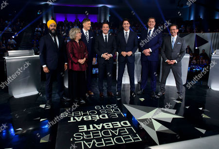 Debate host Patrice Roy from Radio-Canada (C) introduces Canadian federal party leaders NDP leader Jagmeet Singh (L), Green Party leader Elizabeth May (2-L), People's Party of Canada leader Maxime Bernier (3-L), Liberal leader Justin Trudeau (3-R), Conservative leader Andrew Scheer (2-R), and Bloc Quebecois leader Yves-Francois Blanchet (R) before the federal leaders debate in Gatineau, Quebec, Canada, 10 October 2019. Canadians will vote in the country's 43rd general election on 21 October 2019.