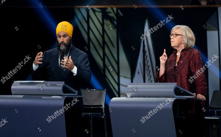 New Democrat Party (NDP) leader Jagmeet Singh (L) and Green Party leader Elizabeth May (R) take part in a Canadian federal political leaders debate in Gatineau, Quebec, Canada, 10 October 2019. Canadians will vote in the country's 43rd general election on 21 October 2019.