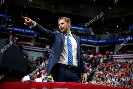 Eric Trump, the son of President Donald Trump points tot he crowd at a campaign rally at the Target Center, in Minneapolis