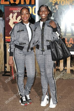 "Tichina Arnold, Alijah Kai Haggins. Tichina Arnold, left, and Alijah Kai Haggins attends the LA Premiere of ""Zombieland: Double Tap"" at the Regency Village Theatre, in Los Angeles"
