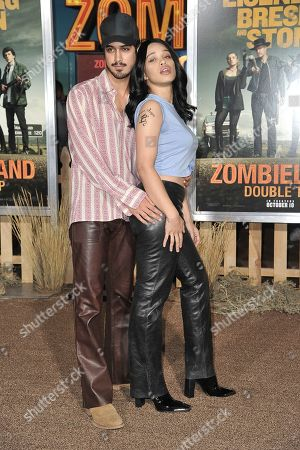 """Stock Photo of Avan Jogia, Cleopatra Coleman. Avan Jogia, left, and Cleopatra Coleman attend the LA Premiere of """"Zombieland: Double Tap"""" at the Regency Village Theatre, in Los Angeles"""