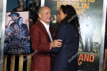 Woody Harrelson (L) hugs US actress Rosario Dawson (R) as they arrive for the premiere of the movie 'Zombieland: Double Tap' at the Regency Village Theater in Los Angeles, California, USA, 10 October 2019. The movie will be released in theaters 18 October.