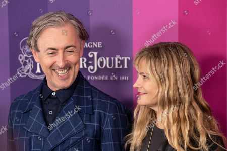 Scottish- American actor Alan Cumming (L) and US actress Jennifer Jason Leigh pose for the photographers on the red carpet at the Milk Studios in Los Angeles, California, USA, 10 October 2019. The amfAR is an international nonprofit organization dedicated to the support of AIDS research, HIV prevention, treatment education, and the advocacy of AIDS-related public policy.