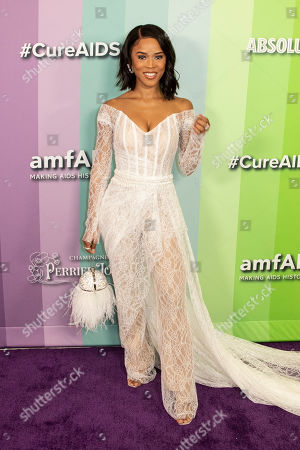 US actress Serayah McNeill poses for the photographers on the red carpet at the Milk Studios in Los Angeles, California, USA, 10 October 2019. The amfAR is an international nonprofit organization dedicated to the support of AIDS research, HIV prevention, treatment education, and the advocacy of AIDS-related public policy.