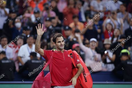 Roger Federer of Switzerland waves to spectators as he leaves the court after he lost to Alexander Zverev of Germany in their men's singles quarterfinals match at the Shanghai Masters tennis tournament at Qizhong Forest Sports City Tennis Center in Shanghai, China