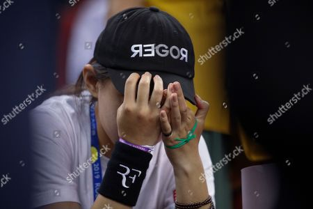 A fan of Roger Federer of Switzerland reacts after Federer lost to Alexander Zverev of Germany in the men's singles quarterfinals match at the Shanghai Masters tennis tournament at Qizhong Forest Sports City Tennis Center in Shanghai, China