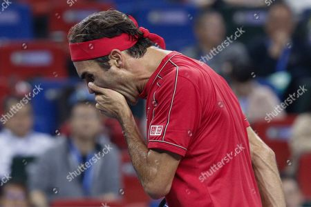 Roger Federer of Switzerland reacts after he lost against Alexander Zverev of Germany in the men's singles quarterfinals match at the Shanghai Masters tennis tournament at Qizhong Forest Sports City Tennis Center in Shanghai, China