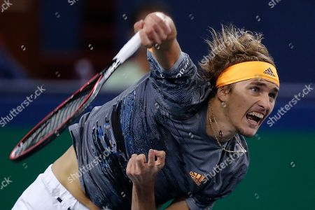 Alexander Zverev of Germany serves against Roger Federer of Switzerland in their men's singles quarterfinals match at the Shanghai Masters tennis tournament at Qizhong Forest Sports City Tennis Center in Shanghai, China