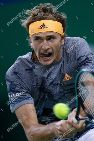 Alexander Zverev of Germany hits a return shot against Roger Federer of Switzerland in their men's singles quarterfinals match at the Shanghai Masters tennis tournament at Qizhong Forest Sports City Tennis Center in Shanghai, China