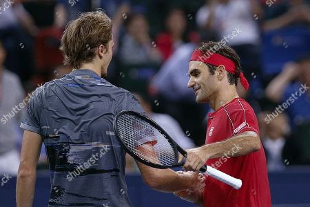 Alexander Zverev, Roger Federer. Alexander Zverev of Germany is greeted by Roger Federer of Switzerland after winning in the men's singles quarterfinals match at the Shanghai Masters tennis tournament at Qizhong Forest Sports City Tennis Center in Shanghai, China