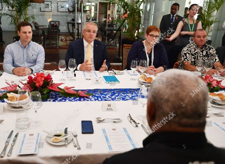 Australian Minister for International Development and the Pacific Alex Hawke (L), Ausstralian Prime Minister Scott Morrison (2-L) and Minister for Foreign Affairs Marise Payne (2-R) meet with the Fiji Prime Minister Frank Bainimarama (R, bottom) at the Grand Pacific Hotel in Suva, Fiji, 11 October 2019. Morrison is on a two-day visit to Fiji.