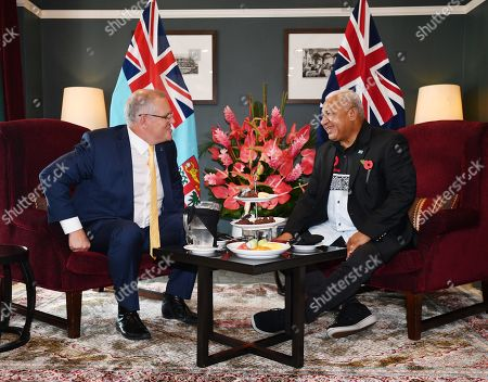 Australian Prime Minister Scott Morrison (L) speaks with Fiji Prime Minister Frank Bainimarama (R) during their meeting at the Grand Pacific Hotel in Suva, Fiji, 11 October 2019. Morrison is on a two-day visit to Fiji.